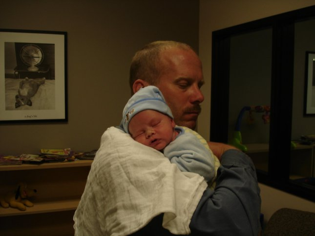 Bill Burns with son Donnelly, 3 weeks old.
